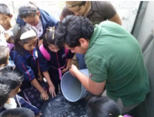 University Autonomous of Querétaro Engineering students teaching elementary students on sanitation and BSF construction and use in a near by village of Colon.